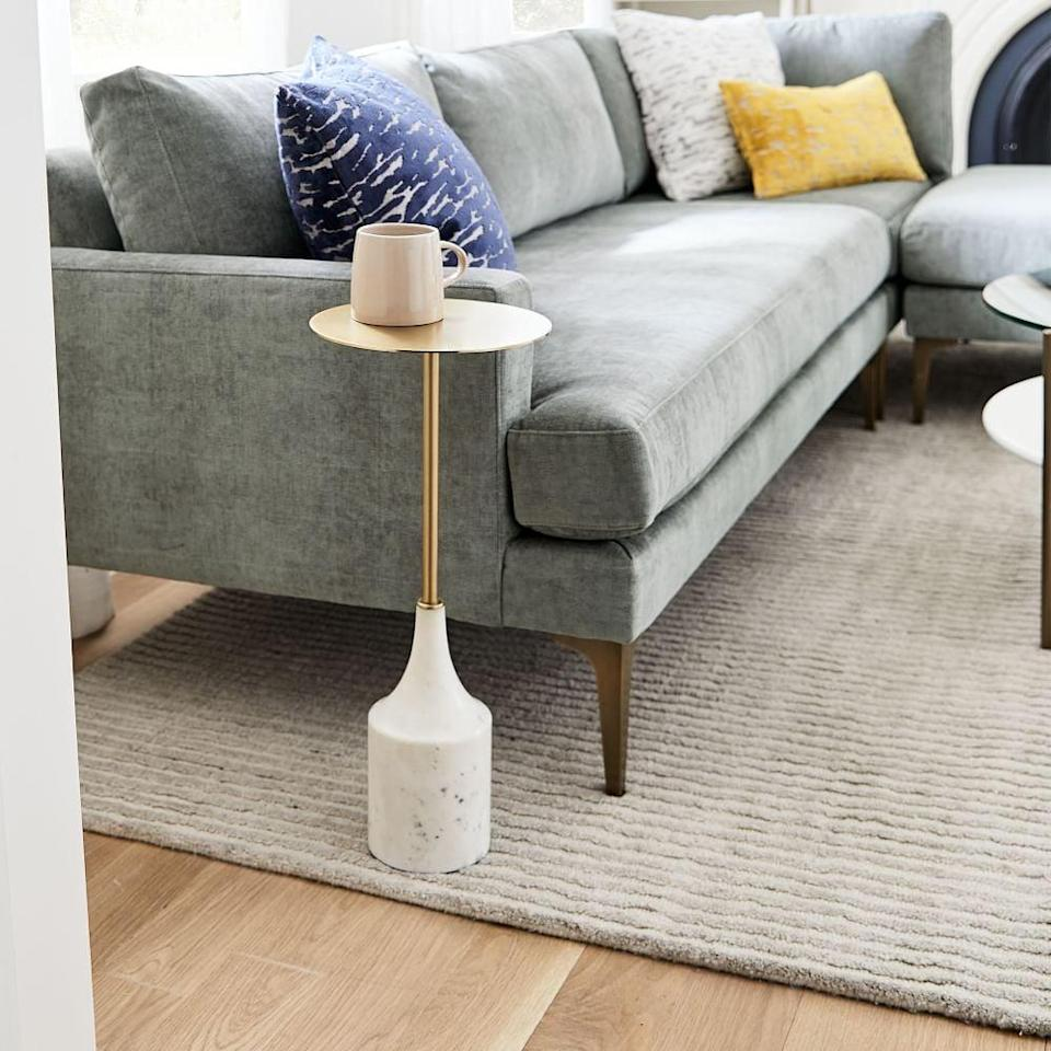 <p>A table for your drink might sound like a stretch, but when we saw the <span>West Elm Hudson Drink Table</span> ($119), we were on board. The mix of marble and gold is just too chic to ignore. It also comes in two other wood finishes.</p>