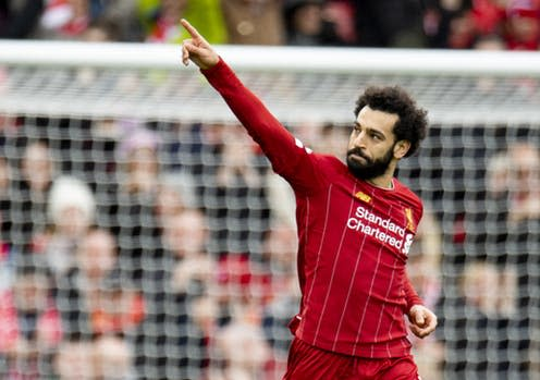 """<span class=""""caption"""">Liverpool's Mohamed Salah celebrates after scoring during a match between Liverpool and Bournemouth in early March, 2020</span> <span class=""""attribution""""><a class=""""link rapid-noclick-resp"""" href=""""https://webgate.epa.eu/webgate"""" rel=""""nofollow noopener"""" target=""""_blank"""" data-ylk=""""slk:Peter Powell\EPA"""">Peter Powell\EPA</a></span>"""