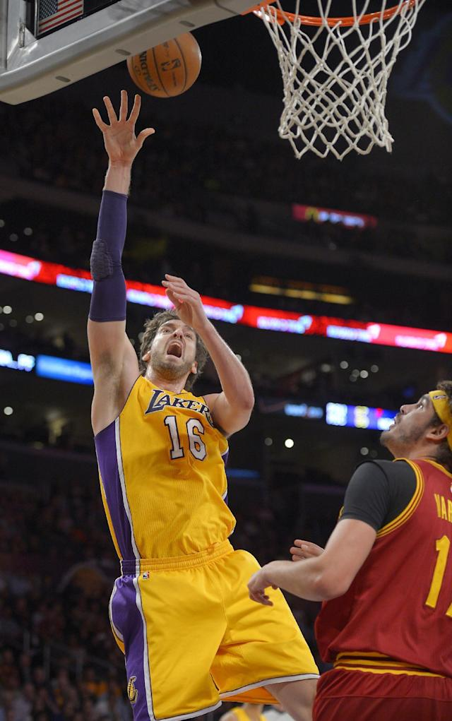 Los Angeles Lakers center Pau Gasol, left, of Spain, puts up a shot as Cleveland Cavaliers center Anderson Varejao, of Brazil, defends during the first half of an NBA basketball game, Tuesday, Jan. 14, 2014, in Los Angeles. (AP Photo/Mark J. Terrill)