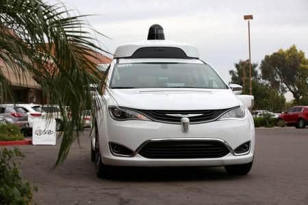 FILE PHOTO: A Waymo Chrysler Pacifica Hybrid self-driving vehicle approaches during a demonstration in Chandler, Arizona
