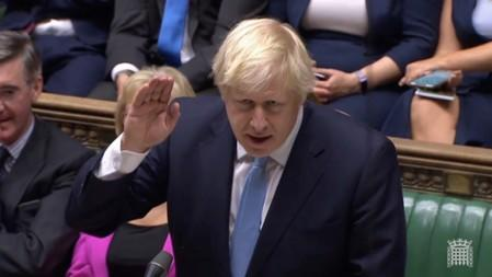 Britain's Prime Minister Boris Johnson speaks after Britain's parliament voted on whether to hold an early general election, in Parliament in London