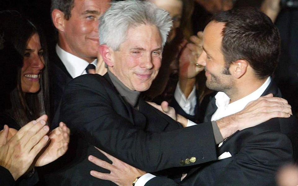 Richard Buckley and Tom Ford after the designer presented his Fall/Winter 2004/05 collection for Gucci during Milan Fashion Week - DANIEL DAL ZENNARO/EPA-EFE/Shutterstock