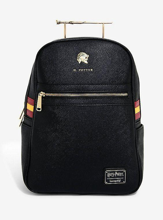 """<p>boxlunch.com</p><p><strong>$79.90</strong></p><p><a href=""""https://go.redirectingat.com?id=74968X1596630&url=https%3A%2F%2Fwww.boxlunch.com%2Fproduct%2Floungefly-harry-potter-harry-wand-mini-backpack---boxlunch-exclusive%2F11802108.html&sref=https%3A%2F%2Fwww.delish.com%2Fkitchen-tools%2Fg4511%2Fharry-potter-gifts%2F"""" rel=""""nofollow noopener"""" target=""""_blank"""" data-ylk=""""slk:BUY NOW"""" class=""""link rapid-noclick-resp"""">BUY NOW</a></p><p>No one will ever be confused over which backpack is yours again. With a <a href=""""https://www.boxlunch.com/product/loungefly-harry-potter-harry-wand-mini-backpack---boxlunch-exclusive/11802108.html"""" rel=""""nofollow noopener"""" target=""""_blank"""" data-ylk=""""slk:name tag and"""" class=""""link rapid-noclick-resp"""">name tag and</a> wand handle fit for the boy who lived and sides adorned in Gryffindor colors, you can show your Hogwarts school spirit easily with this bag. </p>"""