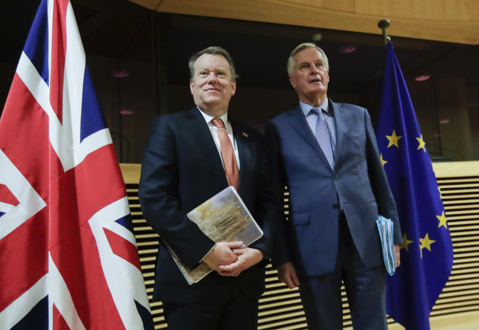 European Union chief Brexit negotiator Michel Barnier, right, speaks with the British Prime Minister's Europe adviser David Frost during the start of the first round of post -Brexit trade talks between the EU and the UK, at EU headquarters in Brussels, Monday, March 2, 2020. Long-awaited trade talks between the EU and Britain kick off Monday amid deep tensions over Prime Minister Boris Johnson's threat to walk away from the talks if not enough progress is made within four months. (Olivier Hoslet. Pool Photo via AP)