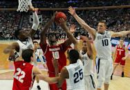 <p>Wisconsin forward Nigel Hayes (10) goes to the basket against Villanova forward Darryl Reynolds, left, guard Donte DiVincenzo (10) and Mikal Bridges (25) during the second half of a second-round men's college basketball game in the NCAA Tournament, Saturday, March 18, 2017, in Buffalo, N.Y. Wisconsin won, 65-62. (AP Photo/Bill Wippert) </p>