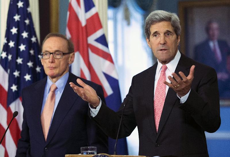 Secretary of State John Kerry, accompanied by Australian Foreign Minister Bob Carr, gestures as he speaks to reporters following their meeting at the State Department in Washington, Monday, March 18, 2013.   (AP Photo/Manuel Balce Ceneta)
