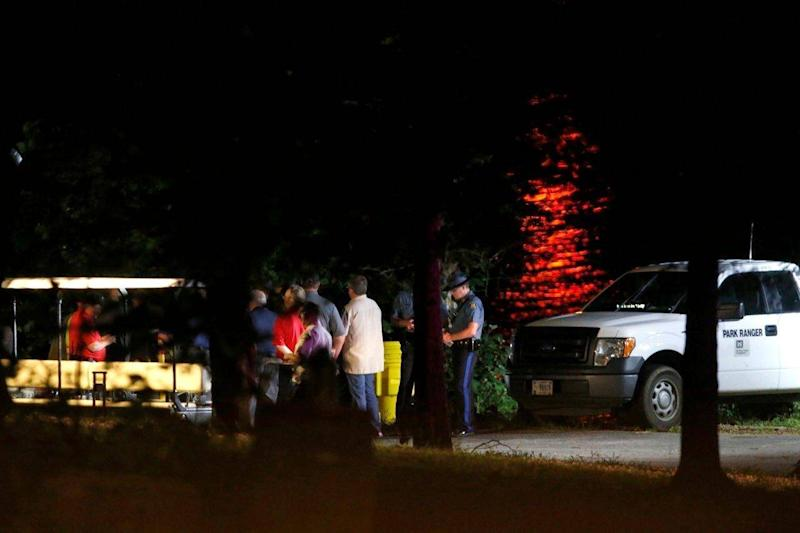 Rescue crews work by the shore of Table Rock Lake (AP)