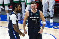 Dallas Mavericks guard Luka Doncic (77) celebrates with teammate James Johnson (16) after making a 3-point basket during the second half of an NBA basketball game against the Boston Celtics in Dallas, Tuesday, Feb. 23, 2021. (AP Photo/Sam Hodde)