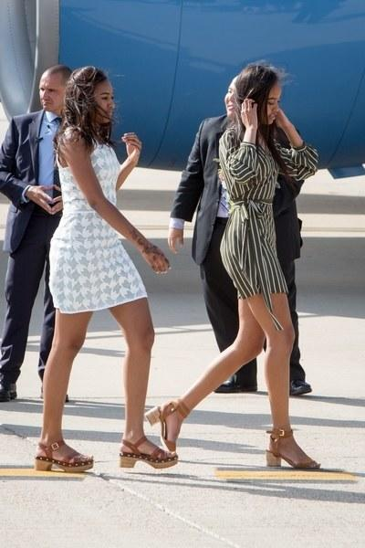 <p>Malia wore a striped wrap dress from Nasty Gal in Madrid, while Sasha wore a blue-and-white houndstooth mini.</p>