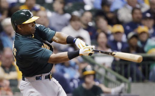 Oakland Athletics' Yoenis Cespedes hits a home run during the sixth inning of a baseball game against the Milwaukee Brewers on Tuesday, June 4, 2013, in Milwaukee. (AP Photo/Morry Gash)