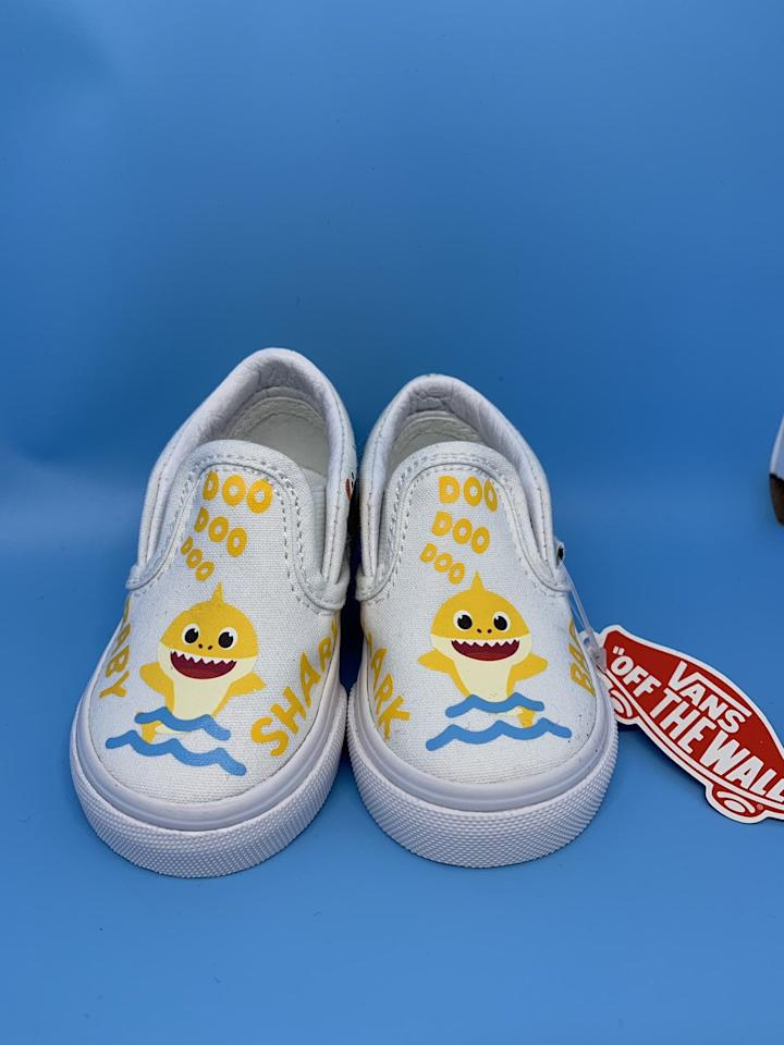 "<p>Spice up any old outfit with a sweet pair of <a href=""https://www.popsugar.com/buy/Yellow-Baby-Shark-Custom-Vans-Slip-Ons-480347?p_name=Yellow%20Baby%20Shark%20Custom%20Vans%20Slip-Ons&retailer=etsy.com&pid=480347&price=65&evar1=moms%3Aus&evar9=46502425&evar98=https%3A%2F%2Fwww.popsugar.com%2Ffamily%2Fphoto-gallery%2F46502425%2Fimage%2F46502437%2FYellow-Baby-Shark-Custom-Vans-Slip-Ons&list1=toddlers%2Cetsy%2Cbabies%2Ckid%20shopping%2Cgifts%20for%20babies%2Cgifts%20for%20toddlers%2Cbaby%20shark&prop13=api&pdata=1"" rel=""nofollow"" data-shoppable-link=""1"" target=""_blank"" class=""ga-track"" data-ga-category=""Related"" data-ga-label=""http://www.etsy.com/listing/702492884/yellow-baby-shark-custom-kids-vans?ga_order=most_relevant&amp;ga_search_type=all&amp;ga_view_type=gallery&amp;ga_search_query=baby+shark+vans&amp;ref=sr_gallery-1-13&amp;organic_search_click=1"" data-ga-action=""In-Line Links"">Yellow Baby Shark Custom Vans Slip-Ons</a> ($65) that have the lyrics printed right on 'em.</p>"