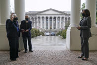 Vice President Kamala Harris participates in a swearing-in ceremony with Treasury Secretary Janet Yellen and Yellen's husband George Akerlof, Tuesday, Jan. 26, 2021, at the White House in Washington. The Treasury building stands behind. (AP Photo/Patrick Semansky)