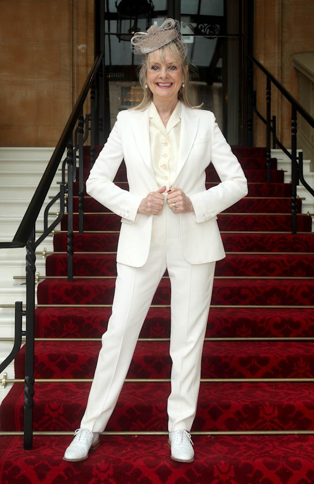 <p>On March 14, Twiggy received a damehood for her commitment to fashion, charity and the arts. The sixties supermodel chose royally-approved Stella McCartney for the occasion – a quintessentially British move. <em>[Photo: Getty]</em> </p>