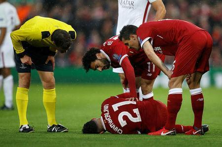Soccer Football - Champions League Semi Final First Leg - Liverpool vs AS Roma - Anfield, Liverpool, Britain - April 24, 2018 Liverpool's Alex Oxlade-Chamberlain after sustaining an injury as Dejan Lovren, Mohamed Salah and referee Felix Brych look on REUTERS/Phil Noble