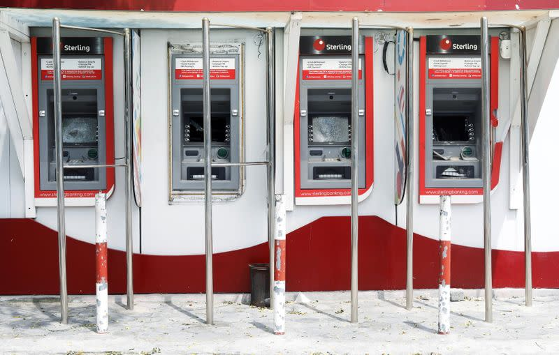 Damaged ATM cash machines are pictured in the Lekki district of the commercial capital Lagos