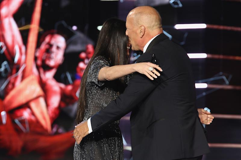 Moore and Willis hug it out after she ribbed him at his Comedy Central roast. (Tommaso Boddi via Getty Images)