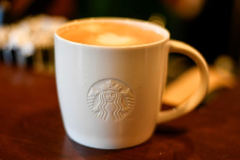 A cup of coffee rests on a counter at a Starbucks coffeehouse in Austin, Texas