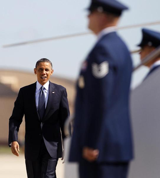 President Barack Obama walks from Marine One to board Air Force One, Wednesday, June 6, 2012, at Andrews Air Force Base, Md., enroute to California. (AP Photo/Carolyn Kaster)