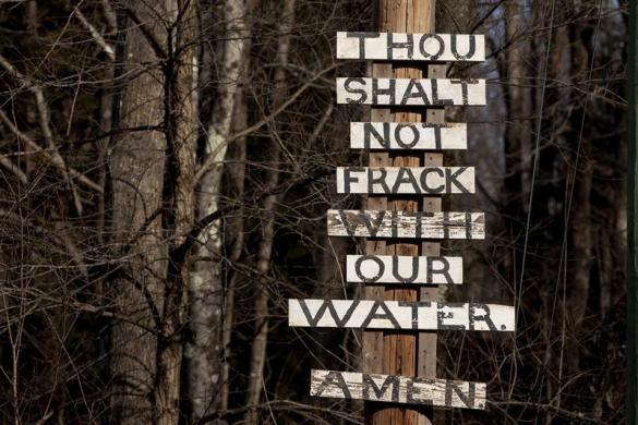 Signs protesting the process of hydraulic fracturing, also known as fracking, are seen near the town of Calicoon Center, New York January 7, 2012.
