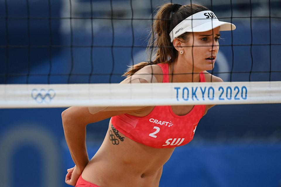 <p>A Rio 2016 Olympic Games tattoo is seen on the ribs area of Switzerland's Joana Heidrich in their women's preliminary beach volleyball pool A match between Switzerland and Germany during the Tokyo 2020 Olympic Games at Shiokaze Park in Tokyo on July 24, 2021. (Photo by Angela WEISS / AFP) (Photo by ANGELA WEISS/AFP via Getty Images)</p>