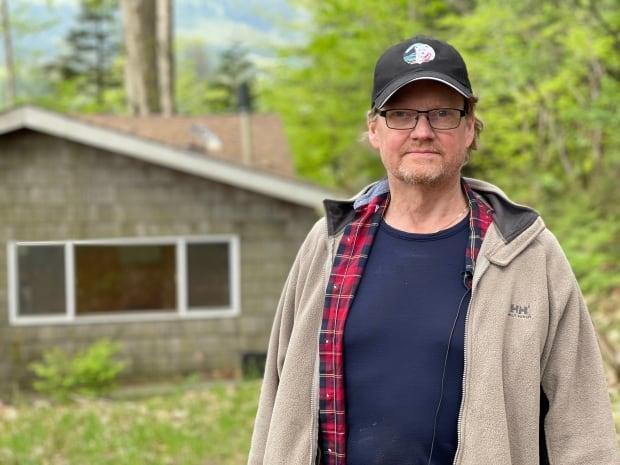 Mike Armstrong and his wife are facing a lawsuit from their former real estate agency over commission after their buyer disappeared before the closing date for two cabins on Lake Errock.  (Christian Amundson/CBC News - image credit)