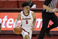 Alabama guard Jaden Shackelford dribbles during the second half of the team's NCAA college basketball game against Auburn on Tuesday, March 2, 2021, in Tuscaloosa, Ala. (AP Photo/Vasha Hunt)