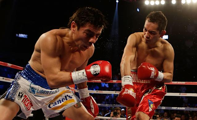 HOUSTON, TX - DECEMBER 15: Nonito Donaire of the Philippines (R) hits Jorge Arce of Mexico in their WBO World Super Bantamweight bout at the Toyota Center on December 15, 2012 in Houston, Texas. (Photo by Scott Halleran/Getty Images)