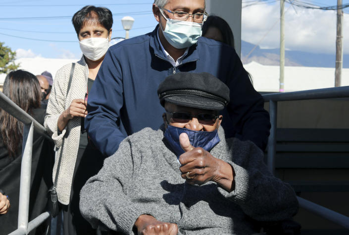Anglican Archbishop Emeritus, Desmond Tutu gestures as he arrives to receive a shot of the COVID-19 vaccine, at the Brooklyn Chest Hospital in Cape Town, South Africa, Monday, May 17, 2021. South Africa has started its mass vaccination drive with the goal of inoculating nearly 5 million citizens aged 60 and above by the end of June. (AP Photo/Nardus Engelbrecht)