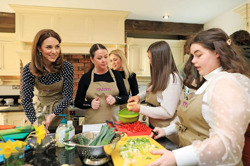 DUBLIN, IRELAND - MARCH 04: Catherine, Duchess of Cambridge helps prepare soup as she visits Savannah House, a residential facility run by charity Extern, in County Meath, north of Dublin on March 4, 2020 (Photo by Julien Behal/Pool/Samir Hussein/WireImage)