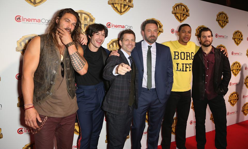 LAS VEGAS, NV - MARCH 29:  (L-R) Actors Jason Momoa, Ezra Miller, director Zack Snyder, actors Ben Affleck, Ray Fisher and Henry Cavill attend the Warner Bros. Pictures presentation during CinemaCon at The Colosseum at Caesars Palace on March 29, 2017 in Las Vegas, Nevada.  (Photo by Gabe Ginsberg/WireImage)