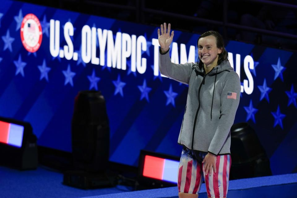 Katie Ledecky waves at the medal ceremony after winning the women's 1500 freestyle during wave 2 of the U.S. Olympic Swim Trials on Wednesday, June 16, 2021, in Omaha, Neb. (AP Photo/Jeff Roberson)