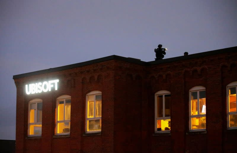 Police check the roof at the offices of gaming software developer Ubisoft in Montreal