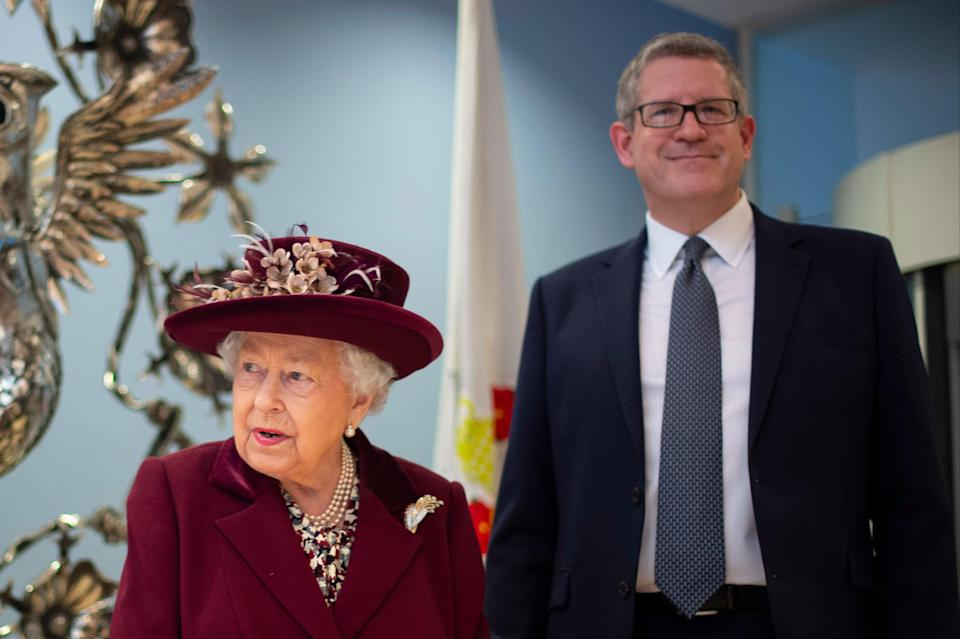 <p>The Queen and Andrew Parker during a visit to MI5 last year</p> (Getty Images)