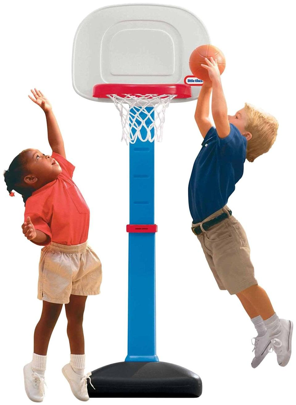 "<p>For a gift that packs a big punch without breaking the bank, Little Tikes's <a href=""https://www.popsugar.com/buy/Easy-Score-Basketball-Set-398623?p_name=Easy%20Score%20Basketball%20Set&retailer=walmart.com&pid=398623&price=30&evar1=moms%3Aus&evar9=25800161&evar98=https%3A%2F%2Fwww.popsugar.com%2Fphoto-gallery%2F25800161%2Fimage%2F36094708%2FLittle-Tikes-Easy-Score-Basketball-Set&list1=gifts%2Choliday%2Cgift%20guide%2Cparenting%2Ctoddlers%2Clittle%20kids%2Ckid%20shopping%2Choliday%20living%2Choliday%20for%20kids%2Cgifts%20for%20toddlers%2Cbest%20of%202019&prop13=api&pdata=1"" class=""link rapid-noclick-resp"" rel=""nofollow noopener"" target=""_blank"" data-ylk=""slk:Easy Score Basketball Set"">Easy Score Basketball Set</a> ($30) can't be beat. The hoop's height is adjustable, so those games of H-O-R-S-E can become more challenging as they get older.</p>"