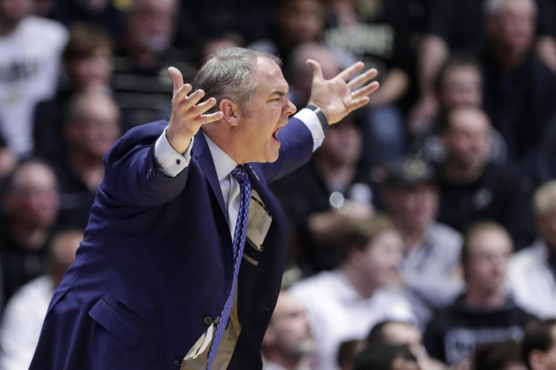 Rutgers head coach Steve Pikiell yells from the bench during the first half of an NCAA college basketball game against Purdue in West Lafayette, Ind., Saturday, March 7, 2020. (AP Photo/Michael Conroy)