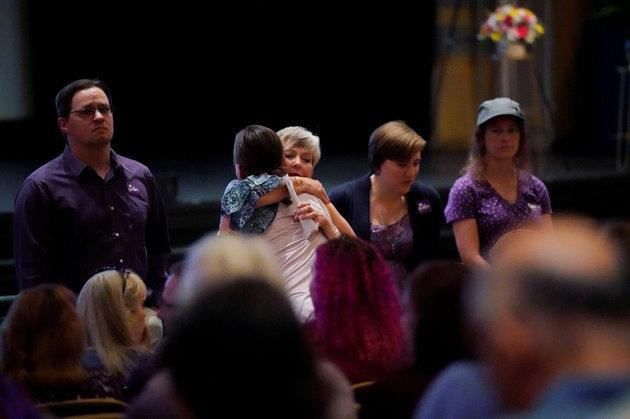 Mourners gather inside the Paramount Theater for a memorial service for Heather Heyer.