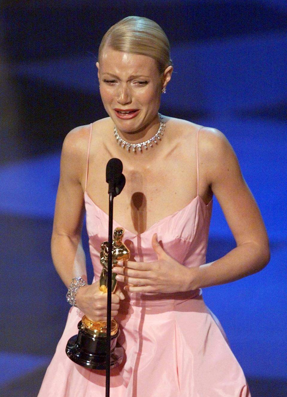 "Gwyneth Paltrow crys as she gives her acceptance speech after winning the Oscar for Best Actress at the 71st Academy Awards March 21, 1999. Paltrow won for her role in ""Shakespeare in Love"".  REUTERS/Gary Hershorn **DIGITAL IMAGE**"