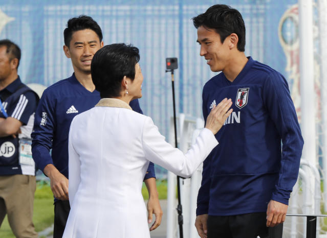 Japan's Princess Takamado, center, speaks with Japan's Makoto Hasebe, right, and Japan's Shinji Kagawa, left, prior to a training session of Japan national team at the 2018 soccer World Cup in Kazan, Russia, Thursday, June 21, 2018. (AP Photo/Eugene Hoshiko)