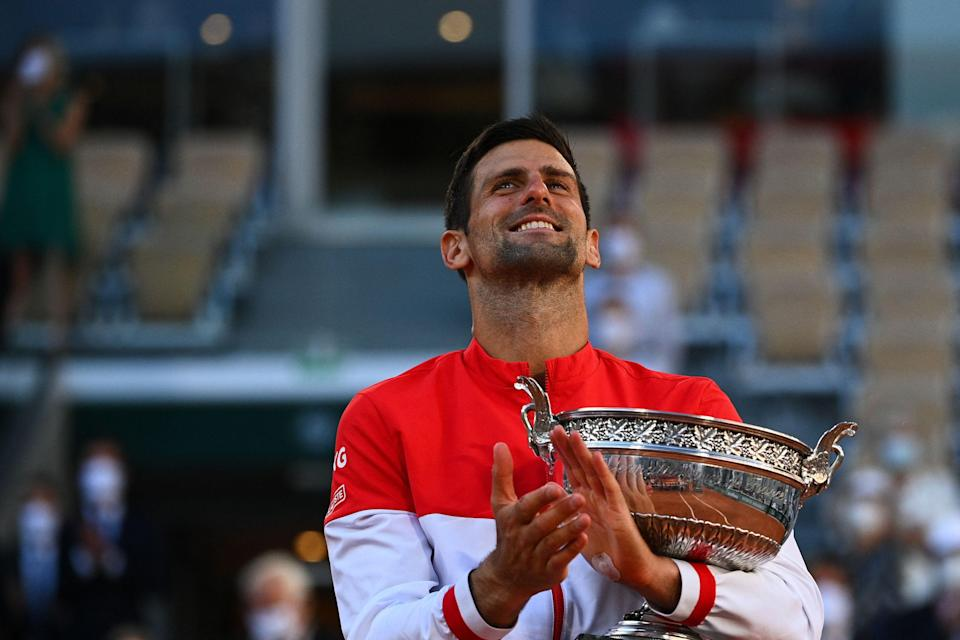 Novak Djokovic poses with The Mousquetaires Cup after his French Open victory.