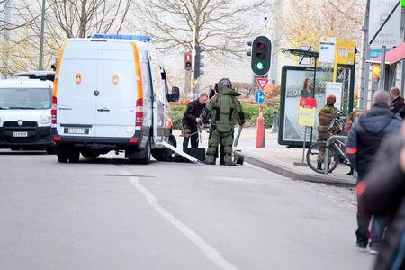 A member of the bomb disposal unit stands in an area of central Brussels on Thursday while bomb disposal experts checked a vehicle carrying gas bottles, a police spokeswoman told local media, in Brussels, Belgium March 2, 2017. REUTERS/Marc Baert