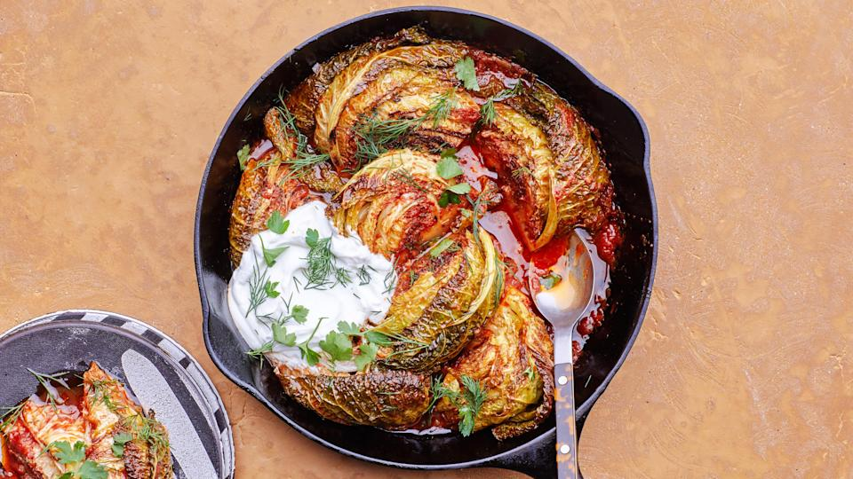 "This is one of the easiest, most delicious ways to cook down a whole head of cabbage until it's falling-apart tender. If the spiced tomato paste has reduced and the pan starts getting dry and dark before the cabbage is ready, just add a splash of water to loosen and let it keep going. <a href=""https://www.bonappetit.com/recipe/caramelized-cabbage?mbid=synd_yahoo_rss"" rel=""nofollow noopener"" target=""_blank"" data-ylk=""slk:See recipe."" class=""link rapid-noclick-resp"">See recipe.</a>"