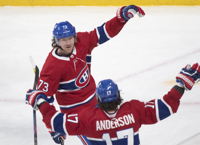 Montreal Canadiens' Tyler Toffoli (73) celebrates with Josh Anderson after scoring against the Winnipeg Jets during the second period of an NHL hockey game Saturday, March 6, 2021, in Montreal. (Graham Hughes/The Canadian Press vIa AP)