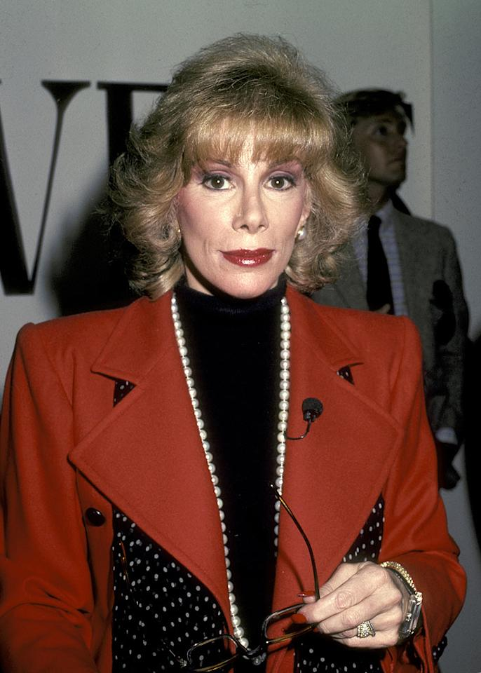 """<a href=""""http://www.getback.com/gallery/celebrity-plastic-surgery/2986253/31"""" target=""""_new"""">Joan Rivers</a> has had nine plastic surgeries, and she's not afraid to say it. So unafraid, in fact, that she's made it the subject of her recent book, """"Men Are Stupid ... and They Like Big Boobs: A Woman's Guide to Beauty Through Plastic Surgery"""" (co-written with Valerie Frankel). Ron Galella/<a href=""""http://www.wireimage.com"""" target=""""new"""">WireImage.com</a> - April 23, 1983"""