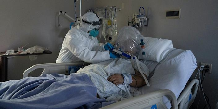 A member of the medical staff at United Memorial Medical Center in Houston, Texas, treats a coronavirus patient on July 28, 2020.