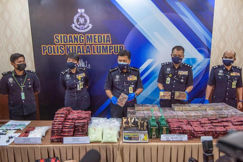KL Police Chief Commissioner Datuk Azmi Abu Kassim (centre) showing the drugs seized at Kuala Lumpur police headquarters June 11, 2021. — Picture by Shafwan Zaidon
