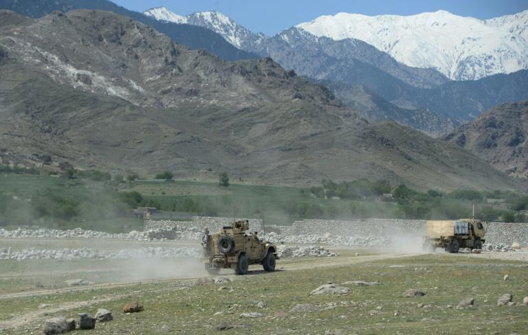 "The US army on patrol after the dropping of the ""Mother Of All Bomns"" on Islamic State group positions in Nangarhar, Afghanistan"