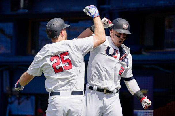 PHOTO: United States' Tyler Austin celebrates his home run with teammate Todd Frazier (25) in the fifth inning of a baseball game against the Dominican Republic at the 2020 Summer Olympics, Aug. 4, 2021, in Yokohama, Japan. (Sue Ogrocki/AP Photo)