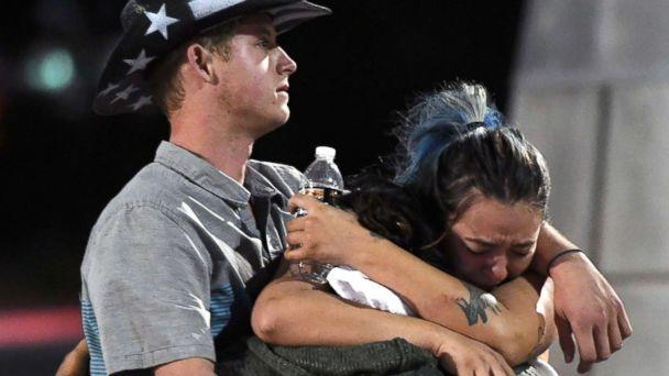 PHOTO: People hug and cry outside the Thomas & Mack Center after a mass shooting at the Route 91 Harvest country music festival, Oct. 2, 2017 in Las Vegas, Nevada. (Ethan Miller/Getty Images)