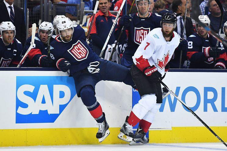 COLUMBUS, OH - SEPTEMBER 9: Blake Wheeler #26 of Team USA reacts after being hit by Jake Muzzin #7 of Team Canada during the second period of an exhibition game on September 9, 2016 at Nationwide Arena in Columbus, Ohio. (Photo by Jamie Sabau/World Cup of Hockey via Getty Images)