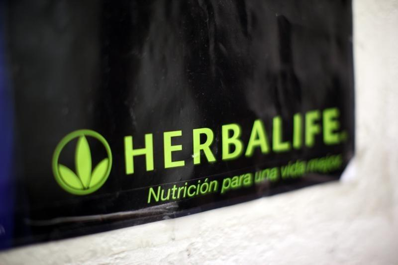A Herbalife logo is shown on a poster at a clinic in the Mission District in San Francisco
